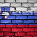 National Flag of Slovenia on a Brick Wall