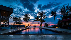 Classic Holiday Brochure Cover Photo (RussellK2013) Tags: wideangle ultrawideangle malaysia langkawi landscape swimmingpool travel vacation vista view sunset lowlight longexposure beach clouds sky hotel colour moody outdoor naturallight palmtrees dusk twilight nikon nikkor ngc tripod 1635mmf4ged 1635mmf4vr 1635mm nightscape