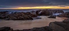 Carrickalinga Cascade (Explored) (*ScottyO*) Tags: ocean longexposure blue sunset sea sky panorama sun seascape beach water yellow clouds landscape golden evening sand rocks waves dusk rocky australia sa southaustralia goldenhour carrickalinga fleurieu