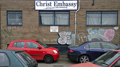 Christ loves you ... (pix-4-2-day) Tags: jesus christ embassy meaning life sign no parking wheel clamp clamping car cars red graffiti parkplatz private privatparkplatz christlich auto window fenster vergittert pix42day