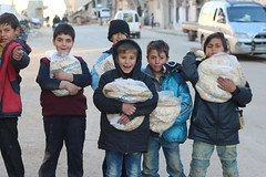 Children in Ariha, Idlib, receive free bread (Ummah Welfare Trust) Tags: poverty children war islam aid hunger arab syria humanitarian إدلب، سوريا‭‬