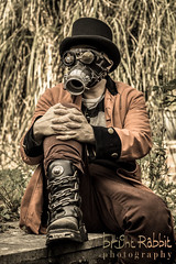 Soldier in garden (Bright Rabbit Photography) Tags: costume mask goggles bowlerhat gasmask costuming pampassgrass bigboots steampunk redjacket gothboots jamesbarton porthwalesunitedkingdomgb porthwales