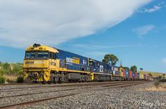MC Mathieson (Henrys Railway Gallery) Tags: nr112 8232 nr32 nrclass ge diesel goninan 82class emd clyde 3mc2 mc2 mathiesonssiding wandong kilmoreeast containertrain freighttrain emptyfreighttrain emptycontainertrain pacificnational pn