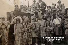 1945: Victory Parade - Highworth Road in Stratton St. Margaret (Local Studies, Swindon Central Library) Tags: swindon wiltshire photograph bw donation brunger alanbrunger 1945 1940s parade ww2 chidlren costume fancydress stm highworthroad stratton strattonstmargaret rowley nurseryrhyme