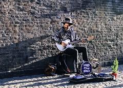 Musician, Brick Lane Market, East London (dawudmarsh) Tags: musician guitarist music livemusic soloartist guitar shadow brickwall street streetlife streetstyle streetmusic londonlife londonstyle london bricklanemarket eastlondon hat mansitting singleperson outdoors