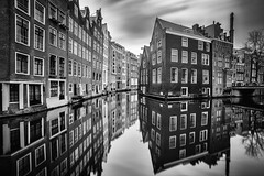 Floating houses (angheloflores) Tags: amsterdam canal floating houses water reflections architecture travel urban explore blackandwhite longexposure clouds sky colors netherlands