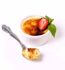 Creme brulee (jerekhough) Tags: creme brulee cream dessert french food sugar sweet cuisine vanilla custard caramel caramelized white delicious catalana pudding yellow gourmet meal brown burnt restaurant eating cooking cookery pastry background ramekin closeup france caramelised baked catalan yummy traditional cafe strawberry berry powderedsugar mint table spoon latvia