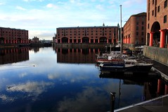 Still Waters (innpictime ζ♠♠ρﭐḉ†ﭐᶬ₹ Ȝ͏۞°ʖ) Tags: water boats buildings sky blue architecture reflection bluesky victorian afloat tugs warehouses yacht docks liverpool albertdock merseyside colonnade maritime stillwater quays columns pillars 1846 533998682991198 azure