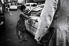 (knet2d) Tags: poverty street leica city people bw monochrome 35mm children blackwhite kid sad candid taxi philippines homeless streetphotography manila isolation summiluc sonya7r