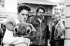Hands off my Stitch! (sawyersource) Tags: street city uk people blackandwhite bw man men london 35mm garden toy person blackwhite holding nikon focus glare stitch teddy britain expression united great expressions streetphotography kingdom covent cuddly pout lad gb frown frowning clutching d7200
