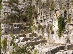 houses cut from rock, piece by piece (Lalallallala) Tags: travel italy italia syracuse siracusa archeologicalpark matka