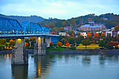 Fall in Coolidge Park - 2015 (Roland 22) Tags: blue autumn red sky orange mist reflection green fall chattanooga rain yellow fog clouds lights evening twilight flickr glow tn fallcolors lamps walnutstreetbridge tennesseeriver coolidgepark