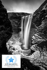 Enter Skógafoss - 2014 ND Awards (Mabry Campbell) Tags: longexposure blackandwhite bw cliff snow art ice water photography photo waterfall iceland rocks photographer image south fine award competition cliffs photograph le april awards scandinavia campbell fineartphotography 2014 architecturalphotography skogafoss 17mm commercialphotography southiceland 2013 architecturephotography portraitorientation southerniceland fineartphotographer architecturalphotographer houstonphotographer holdingpool architecturephotographer skögafoss mabrycampbell ndawards