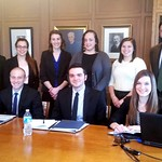 Students pose together in the Miller Board Room with Dr. Fischmar.