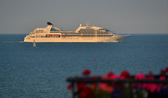 Seabourn Quest (Owen J Fitzpatrick) Tags: dublin tamron ojf nikon fitzpatrick owen j joe d3100 ireland editorial use only white vessel ship passenger cruise deck satdome satcom cabins sleek design bay sea blue vacation holiday ocean luxury cruises underway water seabourn republic red flowers quest profile yacht sail voyage depart golden hour light cruising