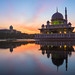 Beautiful Sunrise over a Mosque by the lake with colorful clouds