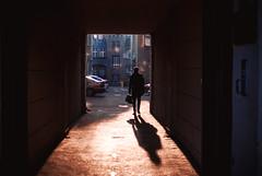 a good start (ewitsoe) Tags: monday man silhouette erikwitsoe ewitsoe nikon d80 35mm street urban city cityscape walking work towork shadow light winter sunny sunrise morning poznan pooalnd briefcase parkingot entrance pasaz polska