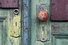 Complex Duplex (Doris Burfind) Tags: door wood colour rot texture abandoned rust decay doorknob ornate peelingpaint keyhole decrepid