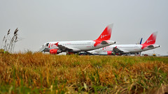 Two red parrots (Nick Aviator) Tags: autumn nature field weather airplane airport cloudy russia moscow aircraft aviation airbus airlines tails vim a319 domodedovo vimavia