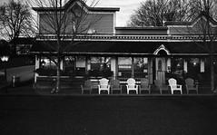 Harborview Cafe L_M6_12556 (erlin1) Tags: november blackandwhite film analog 35mm restaurant cafe chairs dusk visible negativescan wi v1 tmax100 leicam6 2015 lakepepin harborviewcafe