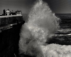 """The Devil whispers ... Old man, You cannot withstand the Storm. The old  Warrior replied ... """" I am the Storm."""" (Đøn@tus) Tags: challenges northatlanticocean stormysea sea courage outdoor blackwhite sfida warrior welle wave onda wasser meer mare tempesta tenerif travel people schärfentiefe schwarzwhite biancoenero textur oldphoto oldman bw dark blancoynegro nikonflickraward wow thefourelements h2o water acqua"""