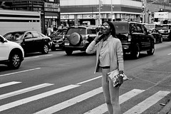 Looking (@tedchang) Tags: nyc blackandwhite woman sunglasses chinatown manhattan cellphone crosswalk sel50f18