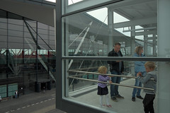 In a glass cage (JarHTC) Tags: family people reflection airport railwaystation transportation fujifilm gdańsk xe2