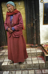 Woman stands in front of a Hindu temple in Nepal