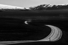 Through Pingvallavegur - Thingvellir (Mabry Campbell) Tags: road blackandwhite mountain mountains monochrome dark landscape photography photo iceland highway europe moody photographer image fav50 nopeople fav20 explore photograph april 100 f80 curve scandinavia fav30 thingvellir fineartphotography curving 200mm roadscape architecturalphotography commercialphotography fav10 southiceland flickrexplore fav100 fav200 fav300 explored editorialphotography 2013 fav40 fav60 architecturephotography fav90 ef200mmf28liiusm fav80 southerniceland fav70 fineartphotographer fav500 fav1000 houstonphotographer fav400 ¹⁄₂₅₀sec fav600 fav700 fav800 fav900 fav1100 fav1200 fav1300 fav1400 mabrycampbell april122013 201304120h6a0223 pingvallavegur
