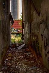 Spaces Between (TwinCitiesSeen) Tags: minneapolis minnesota twincities twincitiesseen canont3i tamron2875mm semi abandoned graffiti