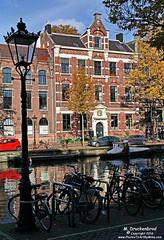 Bikes and Medieval Canal Houses, Kloveniersburgwal, Amsterdam (PhotosToArtByMike) Tags: kloveniersburgwal amsterdam netherlands bikes oldcentre dutch holland centrum centrecity medieval canal nieuwmarkt amstelriver