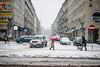 neither sleet nor snow... (ewitsoe) Tags: snow snowing ewitsoe nikond80 35mm street city scape woman umbrella red white snowy winter urban citylife poznan poland polska cars traffic crazyfolks