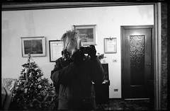 (The Big Freeze) (Robbie McIntosh) Tags: leicamp leica mp rangefinder streetphotography 35mm film pellicola analog analogue negative leicam analogico blackandwhite bw biancoenero bn monochrome argentique autaut dyi selfdeveloped filmisnotdead kodaktmax400 kodak tmax 400 pushed 800iso tetenalultrafinplus ultrafin ultrafinplus strangers elmarit leicaelmarit28mmf28iii elmarit28mmf28iii 28mm selfportrait mirror selfie mask horse freeze coat gloves