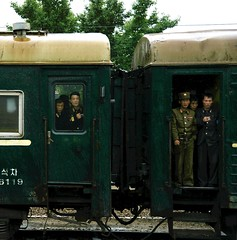 Starring out (Frühtau) Tags: dprk north korea korean train tren treno ferrocarril nordkorea traffic people leute scene watching starring waggon passenger coach zug personen asia asian east country verkehr window fenster door корея северная hamhung street passers by culture daily life 朝鲜 朝鮮 cháoxiān 地 hamhŭngsi south hamgyŏng province outdoor