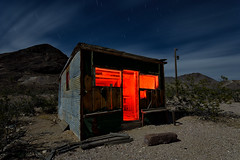 shack. rhyolite, nv. 2016. (eyetwist) Tags: eyetwistkevinballuff eyetwist night red rhyolite shack tin corrugated building ruins goldrush gold mining landmark nevada dark longexposure long exposure startrails star trails fullmoon desert nikon nikond7000 d7000 nikkor capturenx2 1024mmf3545g photography npy nocturne lightpainting flashlight highdesert americana americantypology american typology dead empty wasteland shadows abandoned desolate lonely derelict decay sky dirt nv wideangle 1024mm beatty deathvalley shadow mojavedesert architecture ruin door doorway rubble rocks