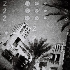 Palms and wind towers (sonofwalrus) Tags: دبي الإماراتالعربيةالمتحدة holga film lomo lomography scan uae unitedarabemirates dubai blackandwhite bw madinatjumeirah palms buildings architecture middleeast