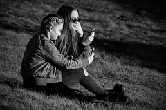 thumb job (Dirty Thumper) Tags: sony nex nex5n mirrorless minolta mc md prime 200mm legacy tele telephoto manual monochrome bw street kraków cracow cracovie krakau クラクフの街 cracovia краков 城市克拉科 city candid people girls cell phone texting sonyphotographing
