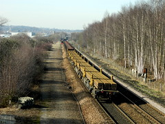 66230 passes Old Denaby to head off down the 'Old Road' with the 6X01 Scunthorpe to Eastleigh loaded rails, 28th Feb 2013. (Dave Wragg) Tags: railway loco locomotive class66 ews networkrail 6x01 66230 olddenaby
