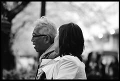 After work. (ykpopy2011) Tags: street people blackandwhite bw woman white man black film monochrome japan pentax bokeh snapshot f18 77 黑白 fa 街拍 散景 單色 pentaxfa77f18limited