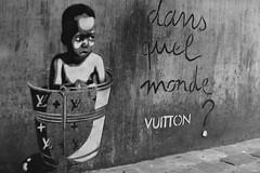 dans quel monde vuitton? (Alexandre Dulaunoy) Tags: poverty street brussels bw streetart art artwork stencil eric belgium belgique bruxelles nb vuitton sooc ezk zeking ericzeking
