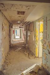 Decaying Hallway (IAmTheSoundman) Tags: fall abandoned broken hospital takumar cloudy decay hallway medical doctor peelingpaint psychiatric urbanexploring operatingroom jakebarshick