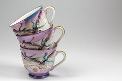 Japanese Teacups (AudioClassic) Tags: teacup cup whitebackground eggshellporcelain japaneseporcelain china saucer antique oldfashioned old classic white floralpattern pattern fragility beautiful gold goldleaf multicolored handle objects equipment