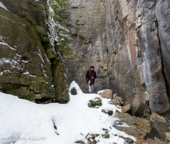 Between a Rock and a Hard Place (maureen.elliott) Tags: brucetrail niagaraescarpment hiking trail rock rockface snow winter nature outdoors figure