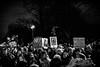 huddled masses. (ii) (jdx.) Tags: history face town flickr protest politics trump donaldtrump inauguration rally newyorkcity newyork nyc centralpark trumphotel centralparkwest people democracy firstamendment freedom blackandwhite blancoynegro noiretblanc schwarzundweiss monochrome fuji fujixseries fujixt2 fujifilm documentary photojournalism streetphotography presidenttrump resist 100daysofresistance michaelmoore reportage jdx