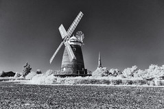 Mill on the Hill (David Feuerhelm) Tags: outdoor bw monochrome nikkor blackandwhite infrared ir silverefex contrast windmill tower brick sails trees sky countyside essex england rural countryside nikon d90 wideangle