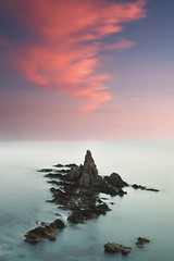 Daydreaming (DavidFrutos) Tags: longexposure sunset sea costa naturaleza seascape beach nature water rock clouds landscape atardecer coast mar interestingness agua rocks waves explorer fineart wave playa paisaje explore filter le lee nubes nd canondslr olas almera cabodegata roca rocas ola 1x1 waterscape filtro largaexposicin filtros gnd neutraldensity explored arrecifedelassirenas canon1740mm gnd4 graduatedneutraldensity densidadneutra interesantsimo davidfrutos 5dmarkii bwnd8 hitechreversegnd06