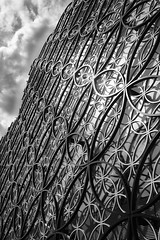 Land of Learning (Idreamofpies) Tags: uk sky urban cloud white black west building monochrome metal wall architecture canon design birmingham pattern britain circles library united central kingdom metalwork learning midlands