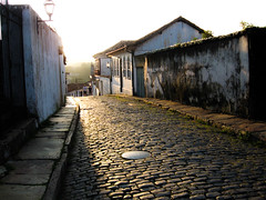 Ouro Preto Streets (D Song) Tags: old city travel blue sunset brazil sky panorama playing mountains streets green heritage church architecture kids buildings children churches panoramic historic unesco cobblestone vista belohorizonte hilly favela ouropreto slums