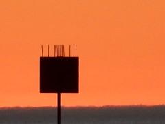 Bird Spikes (mikecogh) Tags: glenelg sunset channelmarker horizon orange glow silhouette spikes fuzzy