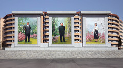 Sinuiju Tryptic (asenseof.wonder) Tags: north korea dprk northkorea asia painting portrait kim building apartment winter sunny border monument 조선 북한